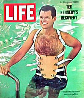 Ted Kennedy practices escaping from a submerged vehicle in 1964