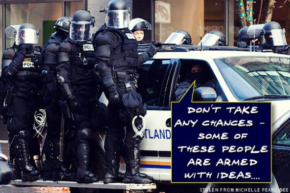 Portland, Oregon police arrive at an Occupy Portland rally to engage in a healthy dialog with protesters.